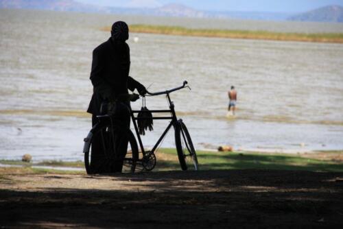 Fisherman on bike